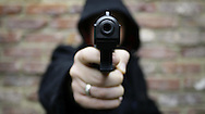 JAMES BOARDMAN / 07967642437 - 01444 412089 .A hoodie brandishes a replica heckler and koch handgun August 23, 2007... .