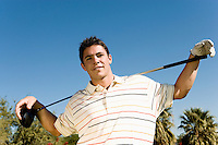 Golfer Holding Club on Shoulders