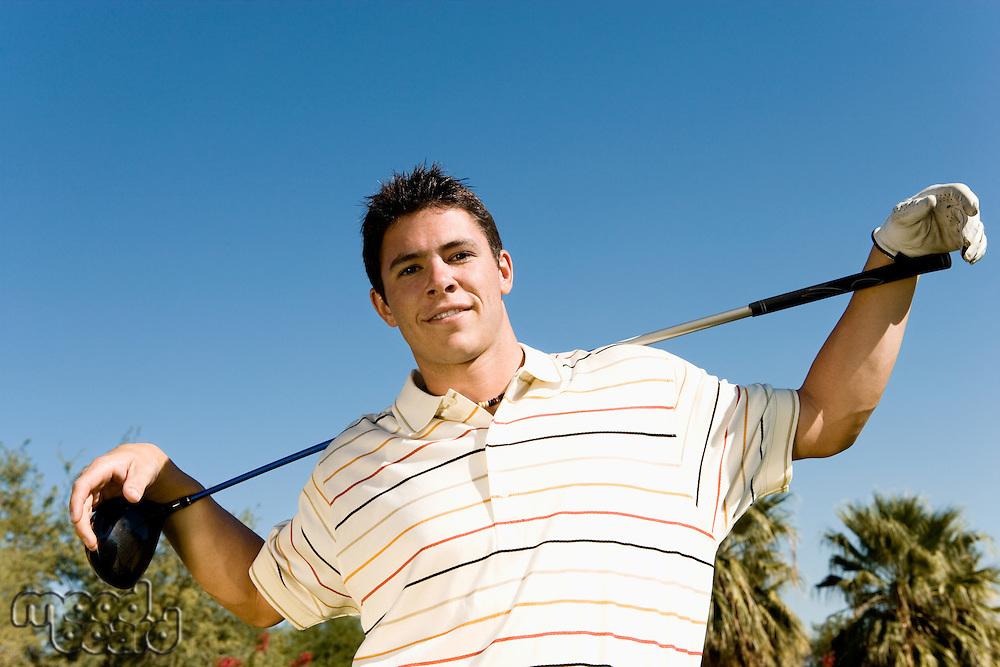 Golfer Holding Club on Shoulders