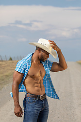 good looking cowboy with open shirt outdoors