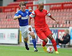 Leyton Orient's Elliot Omozusi under pressure from Ipswich Town's Jay Tabb- photo mandatory by-line David Purday JMP- Tel: Mobile 07966 386802 02/08/14 - Leyton Orient v Ipswich Town - SPORT - FOOTBALL - Pre season - London -  Matchroom Stadium