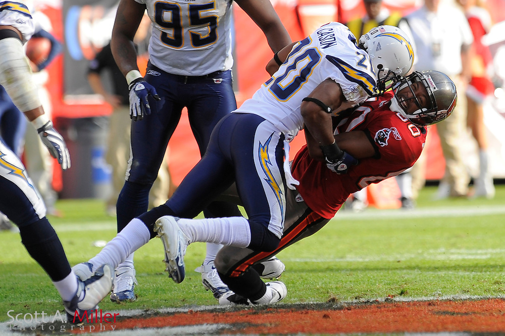 Dec. 21, 2008; Tampa, FL, USA; Tampa Bay Buccaneers wide receiver Antonio Bryant (89) is tackled by San Diego Chargers cornerback Antoine Cason (20) during the second half of the Chargers 41-24 win at Raymond James Stadium. ©2008 Scott A. Miller
