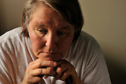 A uninsured senior patient afflicted with polycystic kidney disease, a chronic illness requiring medication and medical treatment, struggles with medical bills.