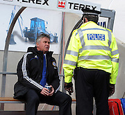 Guus Hiddink talks to a local policeman before the FA Cup Sponsored by E.ON 6th round match between Coventry City and Chelsea at the Ricoh Arena on March 7, 2009 in Coventry, England.