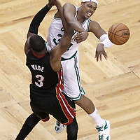 01 June 2012: Boston Celtics small forward Paul Pierce (34) passes the ball over Miami Heat shooting guard Dwyane Wade (3) during the first quarter of Game 3 of the Eastern Conference Finals playoff series, Heat vs Celtics, at the TD Banknorth Garden, Boston, Massachusetts, USA.