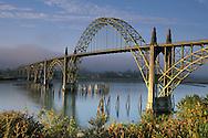Sunrise light on the Yaquina Bay Bridge and fog over Yaquina Bay, Newport, Oregon Coast