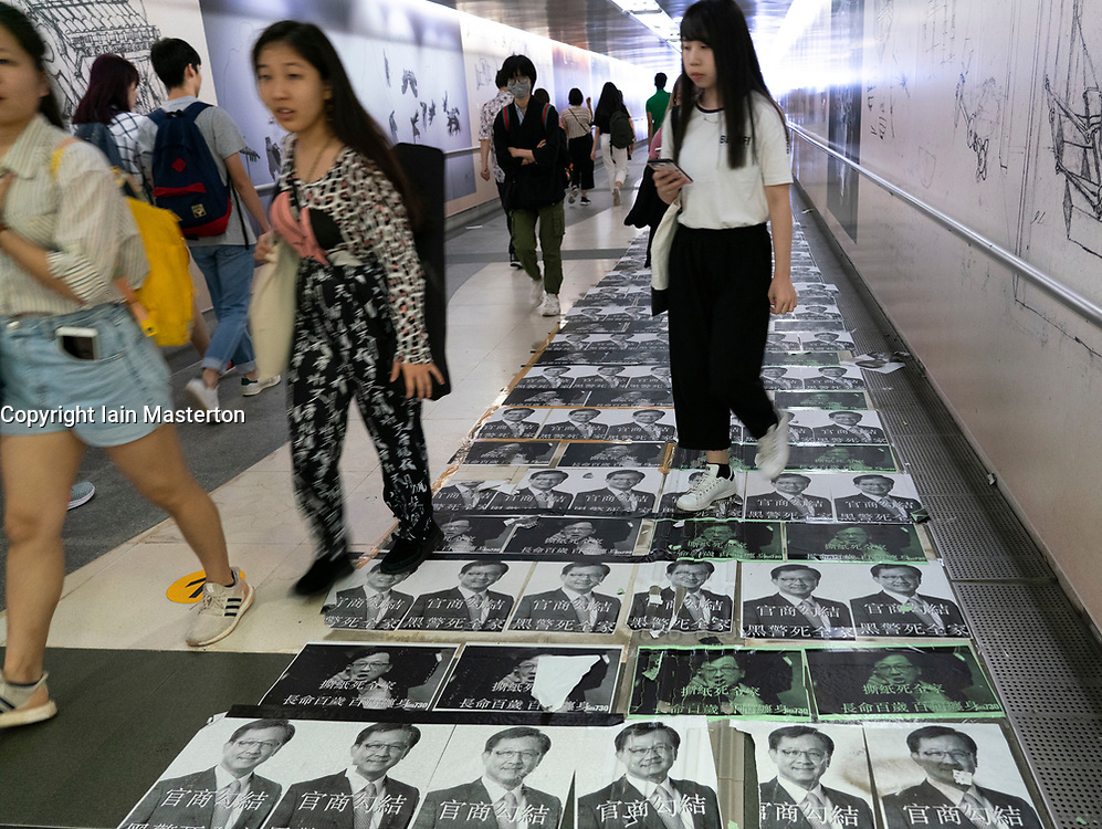 Pro democracy and anti extradition law protests slogans and posters on Lennon Walls in Hong Kong. Subway to City University of Hong Kong posters on floor.