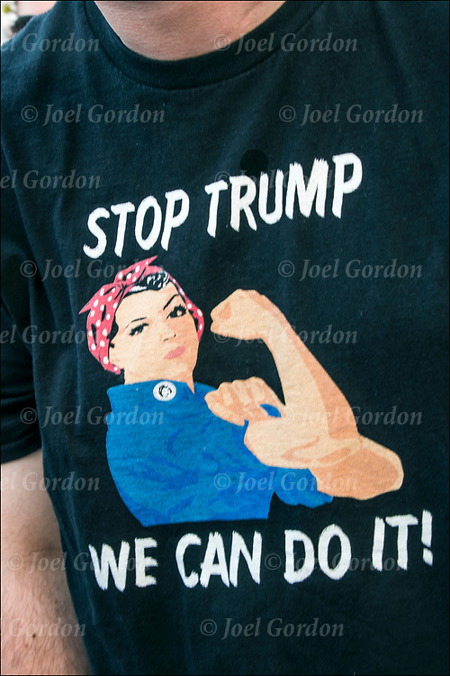 Protester wearing Rosie the Riveter T-shirt &quot;Stop Trump We Can Do It !&quot;  @ Foley Square and then across the Brooklyn Bridge before rallying in Cadman Plaza.<br />