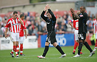 Photo: Rich Eaton.<br /> <br /> Cheltenham Town v Nottingham Forest. Coca Cola League 1. 13/10/2007. Forest's Kris Commons (C) acknowledges the travelling supporters after scoring a hat trick, before being substituted in the second half, watched by Junior Agogo (R).