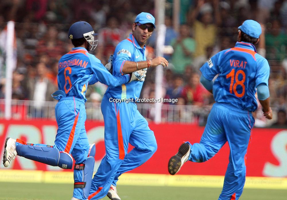 Indian player Yuvraj Singh Celebrates with team mates after take New Zealand batsman Scott Styris catch during the 3rd ODI India vs New Zealand Played at Reliance Stadium, Vadodara, 4 December 2010 (50-over match)