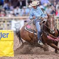 Alexandra Begay makes a turn in the barrel racing competition during the Navajo Nation Fair rodeo at the Navajo Nation Fairgrounds in Window Rock Saturday.