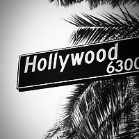 Black and white Hollywood street sign picture. Photo is vertical, high resolution and was taken in 2012 in the Hollywood district of Los Angeles in Southern California.