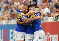 Tom Briscoe (R) of Leeds Rhinos celebrates scoring the 1st try of the game with team mate Jordan Lilley (C) and Mikolaj Oledzki (L) against Castleford Tigers during the Betfred Super League match at the Mend-A-Hose Jungle, Castleford<br /> Picture by Stephen Gaunt/Focus Images Ltd +447904 833202<br /> 08/07/2018