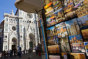 Postcards rack in Piazza Santa Giovanni beneath Florence's Santa Maria del Fiore (Duomo) Cathedral.