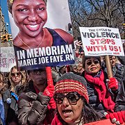 Woman marcher holding sign &quot;Another Victim of Gun Violence In Memoriam Marie Joe Faye, RN&rdquo;<br /> <br /> March for Our Lives in NYC on Central Park West and 72nd Street.<br /> Many got creative with their signs and slogans.<br /> <br /> Hundreds of thousands of protesters, outraged by a recent massacre at a South Florida school and energized by the students who survived, thronged in streets across the globe in protests on Saturday, demanding action against gun violence in their most ambitious show of strength yet.<br /> <br /> In New York, marchers bundled in bright orange &mdash; the official color of a gun control advocacy group &mdash; charged toward Central Park. In Washington, protesters held signs with the messages &ldquo;protesters, outraged by a recent massacre at a South Florida school and energized by the students who survived, thronged in streets across the globe in protests on Saturday, demanding action against gun violence in their most ambitious show of strength yet, surrounded by the echoing chant, &ldquo;Enough is enough!&rdquo;<br /> <br /> The student organizers want action in a midterm year.<br /> <br /> The student activists emphasized that they would soon have access to the ballot box as they hope to build support for candidates who support universal background checks and bans on assault-style weapons.<br /> <br /> The march formation was at 72nd Street between Columbus Avenue and Central Park West and the route was  Columbus Circle and 6th Avenue and Central Park South and 43rd Street and dispearsal at 43rd Street between 5th Avenue and 7th Avenue.