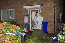 © Licensed to London News Pictures . 12/11/2013 . Manchester , UK . Police and forensic scenes of crime examiners at the scene on Saltdene Road , Woodhouse Park , near Wythenshawe in South Manchester , where two bodies were found this afternoon (Tuesday 12th November 2013 ) . Police report the bodies of a 55 year old man and an 86 year old woman were discovered in the house . Photo credit : Joel Goodman/LNP