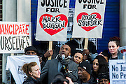"""Supporters of Mark Duggan's family hold a vigil outside Tottenham  police station. They gathered, alongside family members and his mother Pam Duggan, at 2pm following an inquest jury ruling that Duggan was lawfully killed when police shot him dead while he was unarmed.  Within days of his shooting, in 2011, rioting broke out on the streets of London, and spread to other urban areas in England.  Pastor Nims Obunge (pctured with mike) who oversaw Duggan's funeral in 2011, said: """"The message from the family is that this vigil is intended to be a very peaceful vigil"""". Tottenham, London, UK 11 January 2014. Guy Bell, 07771 786236, guy@gbphotos.com"""