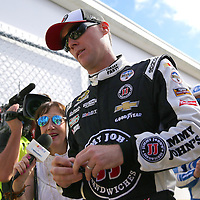 Race car driver Kevin Harvick is seen as he makes his way to the drivers meeting prior to the 58th Annual NASCAR Daytona 500 auto race at Daytona International Speedway on Sunday, February 21, 2016 in Daytona Beach, Florida.  (Alex Menendez via AP)