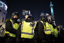 © Licensed to London News Pictures . 05/11/2016 . London , UK . A large police presence around Trafalgar Square . Supporters of Anonymous , many wearing Guy Fawkes masks , attend the Million Mask March bonfire night demonstration , in central London . Photo credit : Joel Goodman/LNP