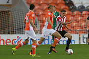 Mark Cullen and Daniel Parslow during the EFL Trophy match between Blackpool and Cheltenham Town at Bloomfield Road, Blackpool, England on 30 August 2016. Photo by Antony Thompson.