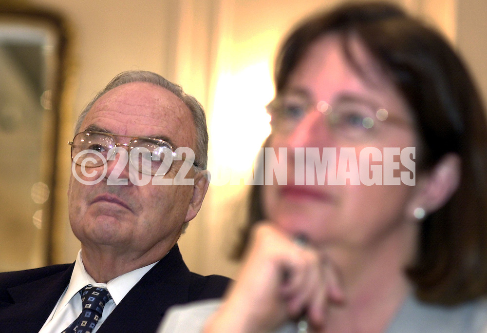Former U.S. Sen. Harris Wofford, left, listens as his son Democratic candidate Dan Wofford, not shown, participates in a Pennsylvania 6th Congressional District candidates forum, sponsored by the AARP, Saturday, October 12, 2002, in Malvern, Pa. The forum is one of nine election forums the AARP is hosting throughout Pennsylvania before election day on November 5th. Woman at right is unidentified. (Photo by William Thomas Cain/photodx.com)