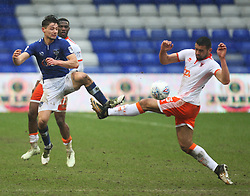 Rob Hunt of Oldham Athletic (L) and Colin Daniel of Blackpool in action - Mandatory by-line: Jack Phillips/JMP - 02/04/2018 - FOOTBALL - Sportsdirect.com Park - Oldham, England - Oldham Athletic v Blackpool - Football League One