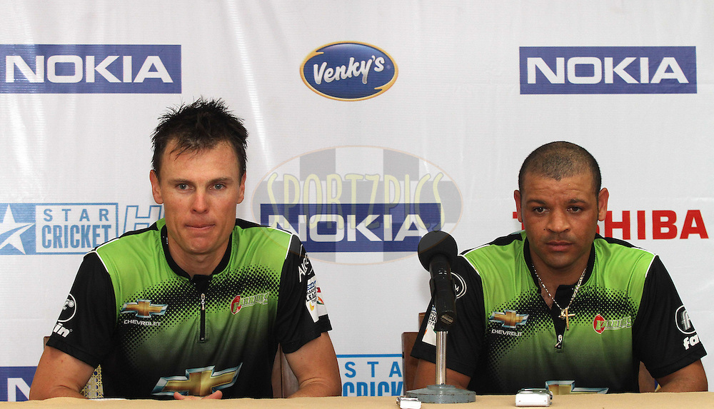 Johan Botha of the Warriors and Ashwell Prince of the Warriors during the post match press conference during match 1 of the NOKIA Champions League T20 ( CLT20 )between the Royal Challengers Bangalore and the Warriors held at the  M.Chinnaswamy Stadium in Bangalore , Karnataka, India on the 23rd September 2011..Photo by Shaun Roy/BCCI/SPORTZPICS