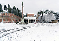 ROME, ITALY - FEBRUARY 26: The Basilica of San Lorenzo outside the walls is covered by snow  in the San Lorenzo district, after the snowfall in the night connected to the arrival of Burian that have whitewashed the capital on February 26, 2018 in Rome, Italy.