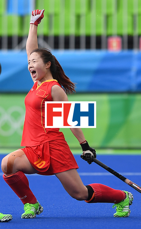 China's Peng Yang celebrates scoring a goal during the women's field hockey China vs Germany match of the Rio 2016 Olympics Games at the Olympic Hockey Centre in Rio de Janeiro on August, 7 2016. / AFP / MANAN VATSYAYANA        (Photo credit should read MANAN VATSYAYANA/AFP/Getty Images)