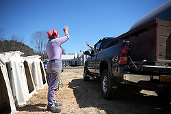 Joan Wortman waves goodbye to Joe Happy and Mark Lindgren, of Hartford, N.Y., after selling them a calf and bull semen at Green Acres in South Randolph, Vt., Saturday, April 16, 2016. (Valley News - James M. Patterson) Copyright Valley News. May not be reprinted or used online without permission. Send requests to permission@vnews.com.
