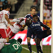 Ibrahim Sekagya and Tim Cahill, (left), New York Red Bulls, combine to score their sides second goal despite the efforts of Jalil Anibaba, (right), Chicago Fire, on the goal line during the New York Red Bulls V Chicago Fire, Major League Soccer regular season match at Red Bull Arena, Harrison, New Jersey. USA. 27th October 2013. Photo Tim Clayton