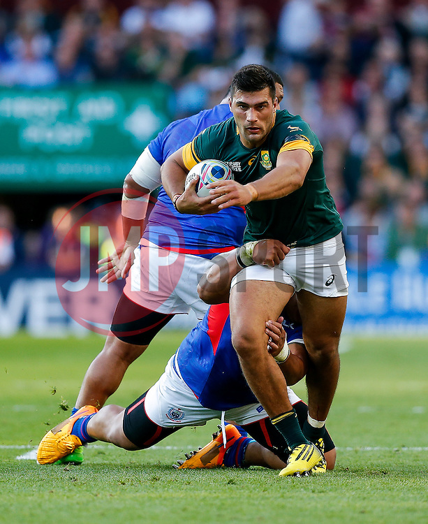 South Africa Inside Centre Damian De Allende is tackled by Samoa Prop Census Johnston and Prop Sakaria Taulafo - Mandatory byline: Rogan Thomson/JMP - 07966 386802 - 26/09/2015 - RUGBY UNION - Villa Park - Birmingham, England - South Africa v Samoa - Rugby World Cup 2015 Pool B.