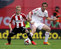Brentford's Alex Pritchard holds the ball up against Middlesbrough's Dean Whitehead - Photo mandatory by-line: Robbie Stephenson/JMP - Mobile: 07966 386802 - 08/05/2015 - SPORT - Football - Brentford - Griffin Park - Brentford v Middlesbrough - Sky Bet Championship
