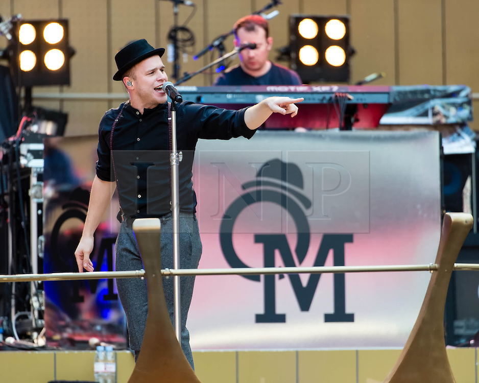 """© Licensed to London News Pictures. 29/06/2013. London, UK.   Olly Murs performing live at Wembley Stadium, supporting headliner Robby Williams.   Oliver Stanley """"Olly"""" Murs is an English singer-songwriter, musician and television presenter. Murs rose to fame after finishing as the runner-up in the sixth series of The X Factor in 2009.   Photo credit : Richard Isaac/LNP"""