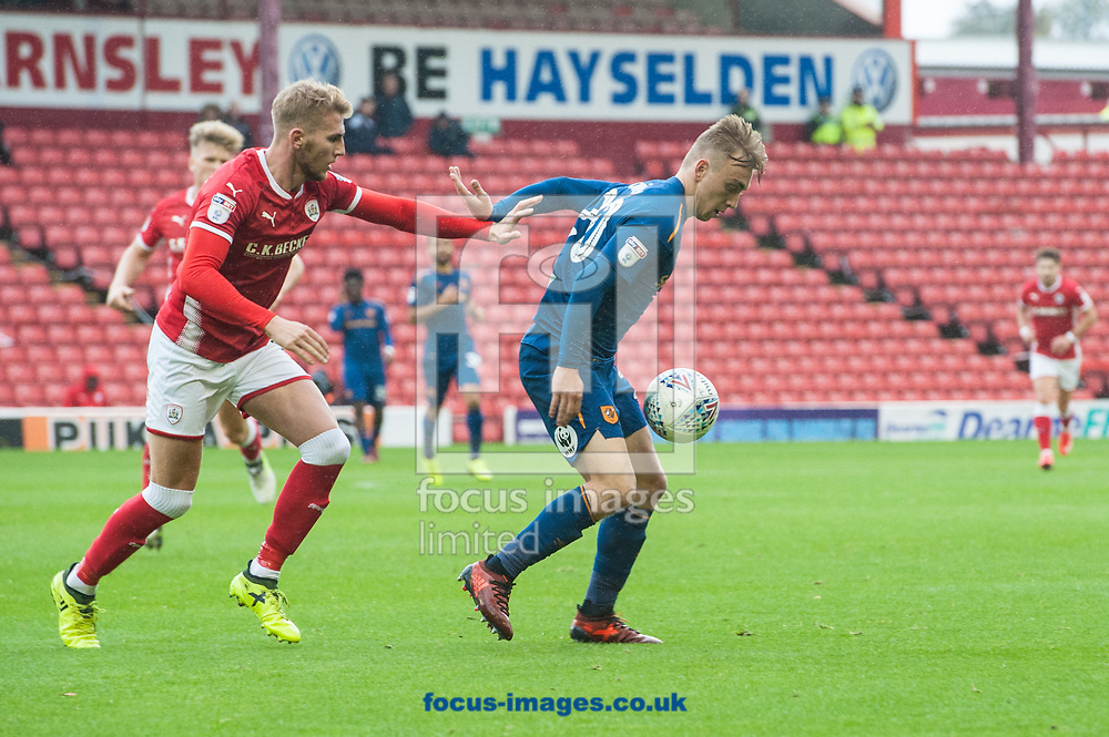 Jarrod Bowen of Hull City holds the ball up from Jason McCarthy of Barnsley during the Sky Bet Championship match at Oakwell, Barnsley<br /> Picture by Matt Wilkinson/Focus Images Ltd 07814 960751<br /> 21/10/2017