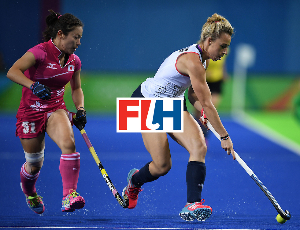 Japan's Hazuki Nagai (L) chases Britain's Susannah Townsend during the women's field hockey Japan vs Britain match of the Rio 2016 Olympics Games at the Olympic Hockey Centre in Rio de Janeiro on August, 11 2016. / AFP / MANAN VATSYAYANA        (Photo credit should read MANAN VATSYAYANA/AFP/Getty Images)