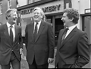 Taoiseach At Kelly's Bakery Kilcock..1986..08.09.1986..09.08.1986..8th September 1986..Today the Taoiseach,Garret Fitzgerald,officially opened a new computer centre at Kelly's Bakery. The bakery is a large employer based in Kilcock,Co Kildare. Mr Fitzgerald was accompanied by the Minister for Justice,Mr Alan Dukes and Mr Bernard Durkan TD...This image shows the Taoiseach,Mr Garret Fitzgerald, at the official opening of Kelly,s new computer centre in Kilcock. Included in the photograph are Mr Canice Kelly,Managing Director,Kelly's Bakery and Mr Pat Smyth,General Manager (right). They all seem to be heartilty enjoying a joke.