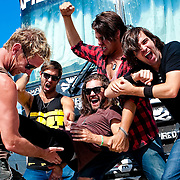Portrait session with After Midnight Project after their performance at KROQ's Epicenter '09: Presented By Rogue at the Fairplex on August 22, 2009 in Pomona, California. Pictured from left: TJ Armstrong, Spencer Bastian, Jason Evigan, Dan Morris; held aloft: Christian Meadows.