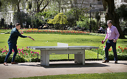 © Licensed to London News Pictures. 04/05/2018. London, UK. Two men play a game of ping-pong in Whitehall Gardens in Westminster in afternoon sunshine. High temperatures are expected to continue throughout the bank holiday weekend. Photo credit: Peter Macdiarmid/LNP