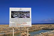 Sign notice at historic ancient salt pans on coast near Marsalforn, island of Gozo, Malta