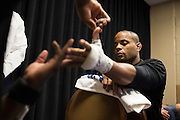 Daniel Cormier has his hands wrapped backstage before his fight against Anthony Johnson during UFC 187 at the MGM Grand in Las Vegas, Nevada on May 23, 2015. (Cooper Neill)