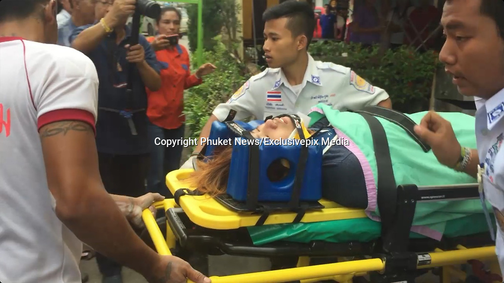 "Phuket Police dismiss rape rumours in woman's in four-story fall from building<br /> <br /> Police have dismissed rumours that a 21-year-old woman was raped, leading to her falling from the fourth floor of a building in Phuket Town this morning (May 5).<br /> <br /> Phuket City Police Chief Col Kamol Osiri and Deputy Superintendent Lt Col Chao Phomna both arrived in person, as did Pol Capt Virat Khongkhawhai, who received the report.<br /> <br /> The woman* was in a state of deep distress, and hung one leg over the ledge, pulled it back and then swung the other leg over in seeming indecisiveness over whether to launch herself over the side of the building.<br /> <br /> Kusoldharm rescue workers and officers from the Phuket City branch of the Department of Disaster Prevention and Mitigation attempted to talk the woman back to safety, but she climbed over the edge and ended up grabbing hold of a small seam in the bricks to prevent her from falling further.<br /> <br /> Unable to recover the woman from the side of the building, the woman fell, plunging three stories onto the ground-floor awning below before bouncing onto the concrete street.<br /> <br /> The woman was bleeding from the head as rescue workers rushed her to Vachira Phuket Hospital.<br /> <br /> The woman, originally from Bangkok, lived on the third floor of the building, a woman who said she was a friend to the victim told The Phuket News at the scene.<br /> <br /> The friend said the woman was working in Phuket, but did not specify what she did to make a living.<br /> <br /> In the woman's room, police found four A4 sheets of paper with hand-written messages that officers believe were written by the woman. The messages explained how she felt she had failed in her life and that no one understood her.<br /> <br /> Phuket City Police Chief Col Kamol explained to The Phuket News this afternoon, ""We heard the rumours that the woman said she had been raped and I ordered my investigators to look into this.<br /> <br /> ""My investigators said the reason for this incident was about that she had been raped. The real cause is that she"