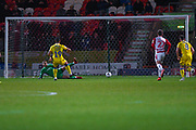 Jonson Clarke-Harris of Bristol Rovers (19) scores a penalty goal to make the score 4-1 by sending Marko Maroši of Doncaster Rovers (13) the wrong way during the EFL Sky Bet League 1 match between Doncaster Rovers and Bristol Rovers at the Keepmoat Stadium, Doncaster, England on 26 March 2019.