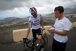 F.A.O Lisa McCLean Daily Telegraph picture desk. ©Ben Cawthra. 19/05/2012. Tenerife, Spain. Three time Olympic gold medalist, cyclist Bradley Wiggins (left) talking with his head conditioner Tim Kerrison (right) during training on the roads surrounding the volcanic island of Tenerife in Spain. Photo credit: Ben Cawthra