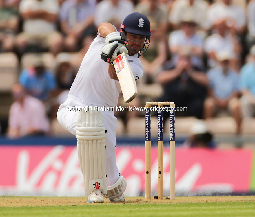 Alastair Cook overtakes Kevin Pietersen in the list of England run scorers with this shot in the third Investec Test Match between England and India at the Ageas Bowl, Southampton. Photo: Graham Morris/www.cricketpix.com (Tel: +44 (0)20 8969 4192; Email: graham@cricketpix.com) 27/07/14
