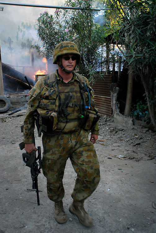 Australian Peacekeeper. Australian peacekeepers provide security for East Timorese fire-fighters, the Bombeiros, attempt to put out a major fire lit by feuding gangs in Calico, near the Old Market area, as continual violence, looting and arson disrupt Dili.  Acts of arson across Dili have become a continual occurrence. .07/06/06