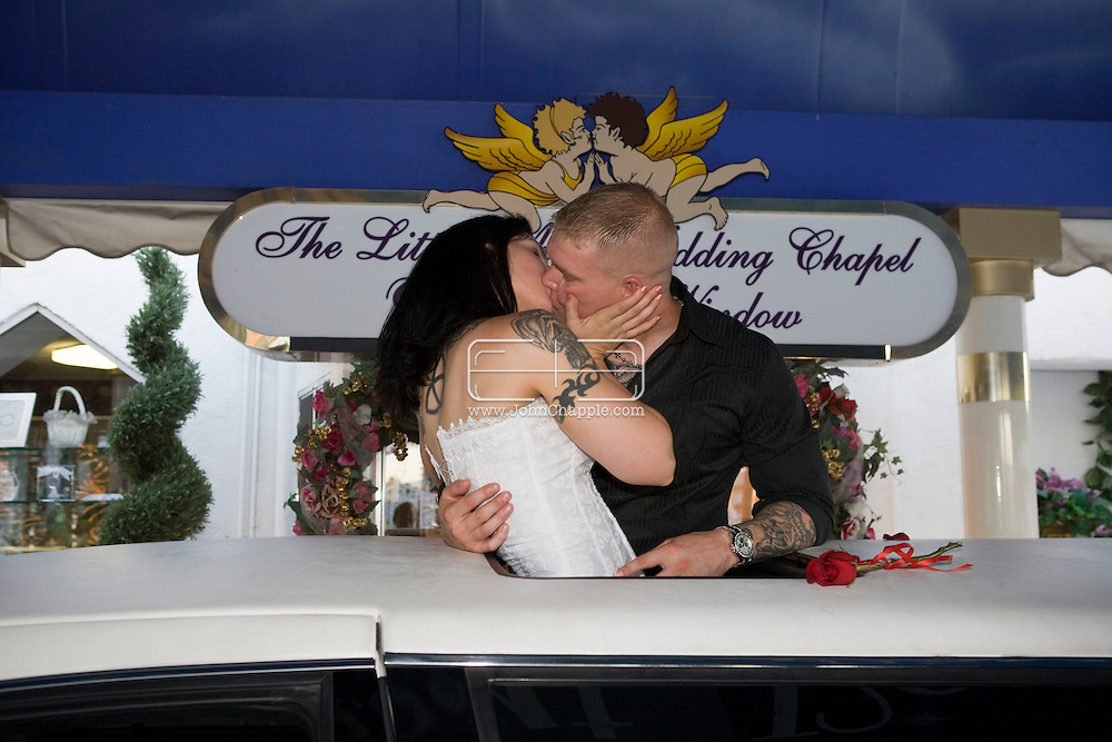 5th June 2010. Las Vegas, Nevada. Known around the world as one of the most Famous places to be married, The Little White Wedding Chapel in Las Vegas has wed stars from Britney Spears to Judy Garland. Pictured are Marines Mark Damm, 28, from Kansas and Jessica Coco, 29, from Louisiana, who took their vows while standing through the sunroof of a white stretch limo.. PHOTO © JOHN CHAPPLE / www.chapple.biz.john@chapple.biz  (001) 310 570 9100.