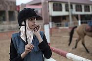 The veil is the only traditional cloth that the girls wear at the al Fares horse riding club.