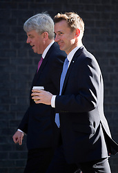 © London News Pictures. 23/04/2013. London, UK.    Leader of the House of Commons Andrew Lansley (Left) and Health Secretary Jeremy Hunt (right) on Downing Street in London for cabinet meeting. Photo credit: Ben Cawthra/LNP.