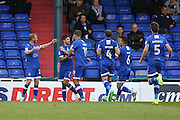 Ryan Flynn of Oldham Athletic celebrates with his team mates after scoring the opening goal to make it 1-0 during the EFL Cup match between Oldham Athletic and Wigan Athletic at Boundary Park, Oldham, England on 9 August 2016. Photo by Simon Brady.